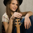 Teenager girl with electric guitar — Stock fotografie