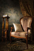Luxurious vintage interior with armchair — Stock Photo