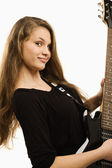 Happy teenager girl playing guitar — Stock Photo