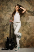Teenager girl with electric guitar — Stock Photo