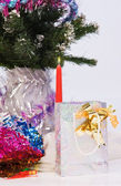 New Year gift on a fir branches background — ストック写真
