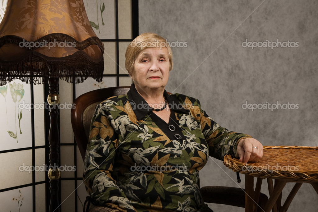 Portrait of a lovely old woman in a vintage style interior — Stock Photo #10480167