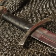 Medieval sword and hauberk — Stock Photo