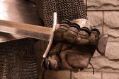 Sword in a hand of knight — Stock Photo