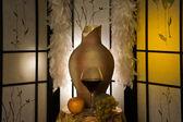 Jug, wine glass in a luxurious interior — Stockfoto