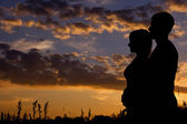 Silhouette of a young couple — Stock Photo
