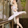 Ballerina in rich interior - Foto Stock