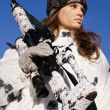 Sniper girl in white camouflage on a blue sky background — Stock Photo