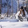 Sniper girl in white camouflage at winter forest. — Stock Photo #10515460