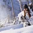 Sniper girl in white camouflage at winter forest. — Stock Photo #10515477