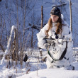 Stock Photo: Sniper girl in white camouflage at winter forest.