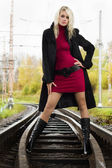 Beautiful woman on railway tracks — Stock Photo