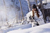 Sniper girl in white camouflage at winter forest. — Stock Photo