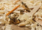 Gold miniature wood planer on wooden plank — Stock Photo