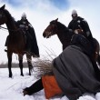 Scared peasant and riding knights Hospitallers - ストック写真