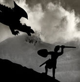 Medieval knight fighting the dragon — Stock Photo
