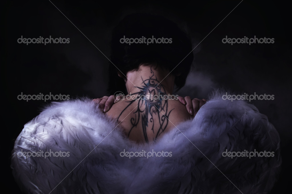 Beauty angel girl over dark sky background — Stock Photo #10566603