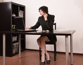 Confident secretary in a office — Stock Photo