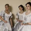 Three young women in ball gowns - Stock Photo