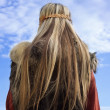 Viking girl on a blue sky background — Stock Photo
