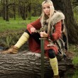 Viking girl with sword in a wood — Stock Photo #9047464