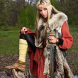 Viking girl with sword in a wood — Stock Photo #9047736