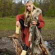 Stock Photo: Viking girl with sword in wood