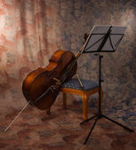 Old cello and music stand — Stock Photo