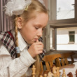 Little girl plays chess — Photo
