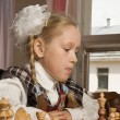 Little girl plays chess — Stock Photo