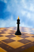 Chess figure on a chessboard — Stock Photo