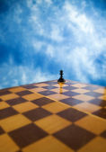 Chess pawn on a chessboard — Stock Photo