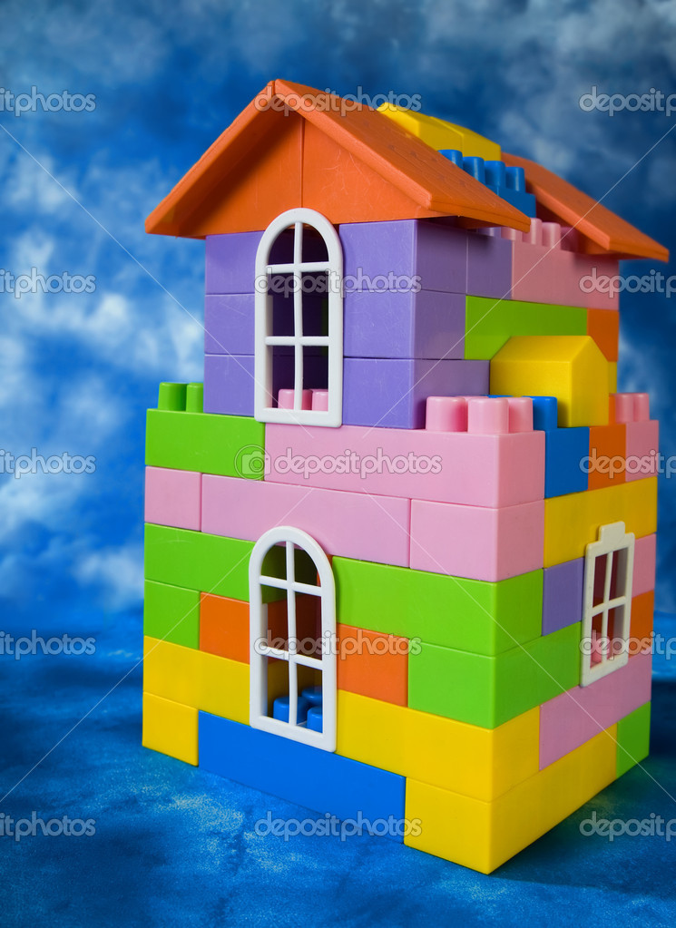 Toy house model on a blue sky background — Stock Photo #9187208