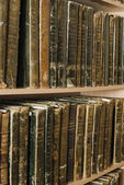 Book shelfs with old archival books of 19 centuries — Stock Photo