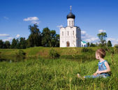 Little boy on a orthodox church background — Stock Photo