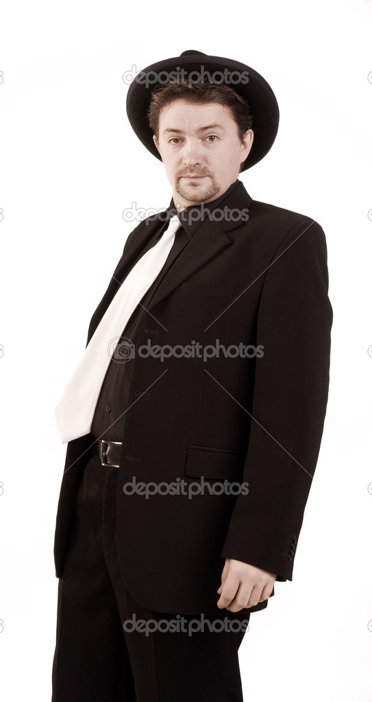 Drunkard in a black hat and a black suit — Stock Photo #9440075