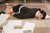 Lifeless businesswoman in a office — Stock Photo