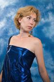 Beautiful blonde woman in dark blue fabric — Stock Photo