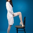A pretty young nurse straightens stockings — Stock Photo