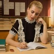 Confident school girl at her desk — Stock Photo #9778055