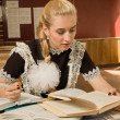 Confident school girl at her desk — Stock Photo #9778115
