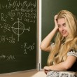 Happy school girl on math classes finding solution — Stock Photo