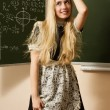 Pretty school girl on math classes finding solution — Stock Photo