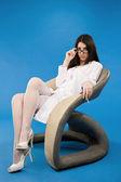 Pretty nurse sitting in a chair — Stock Photo
