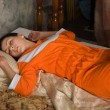 Brunette asleep in a luxury bedroom - Foto de Stock