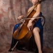 Woman in evening dress playing cello - Stock Photo