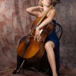 Attractive woman in evening dress with cello - Stock Photo