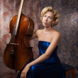 Stock Photo: Attractive womin evening dress with old cello