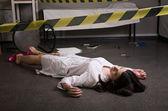 Nurse lying on the floor — Stock Photo