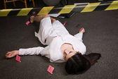 медсестра, лежа на полу — Стоковое фото